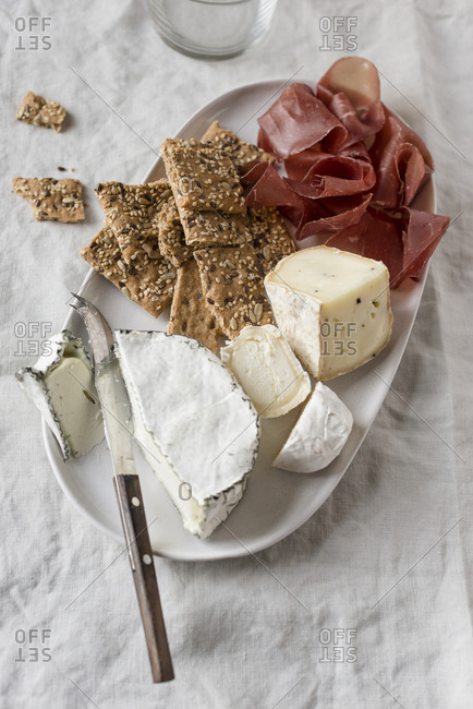 Cheese platter with crackers and bresaola