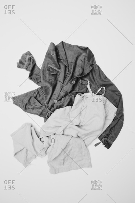 Linen shirt and pants on white background