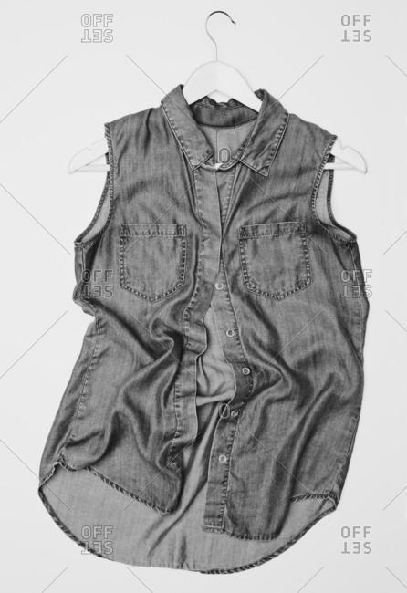 Sleeveless denim shirt on hanger