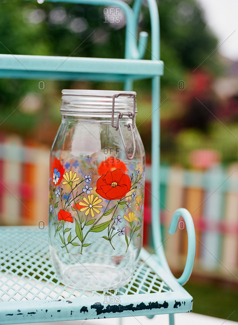 Large decorative glass jar on outdoor furniture