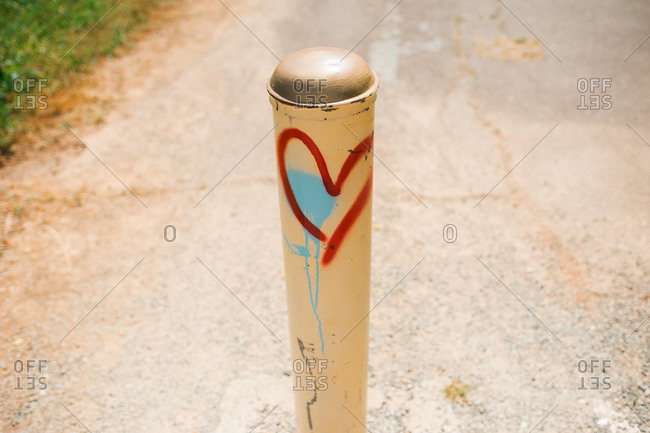Heart painted on post