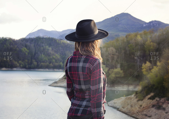 Woman watching mountains and the lake below