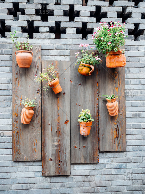 Clay pots attached to a brick wall