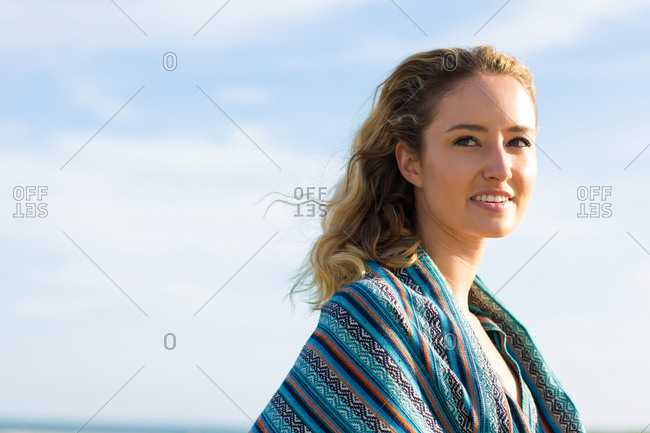Portrait of blonde woman at sunset
