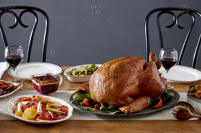 Turkey with side dishes on Thanksgiving table