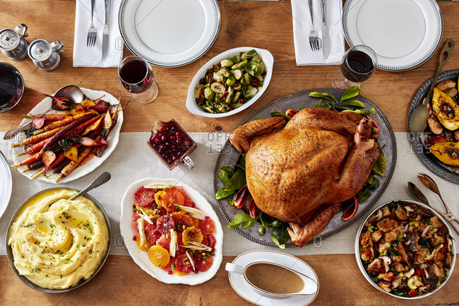 Overhead view of Thanksgiving table with turkey and sides