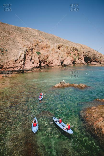 Peniche, Portugal - February 4, 2017: People kayaking in coastal waters