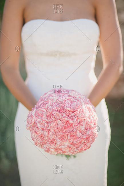 Bride holding a round bouquet