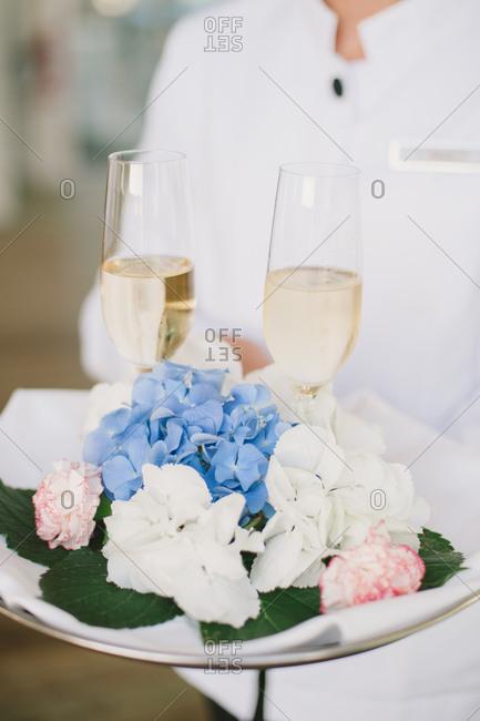 Wedding caterer serving drinks