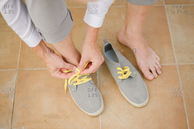 Groom tying his  casual shoes