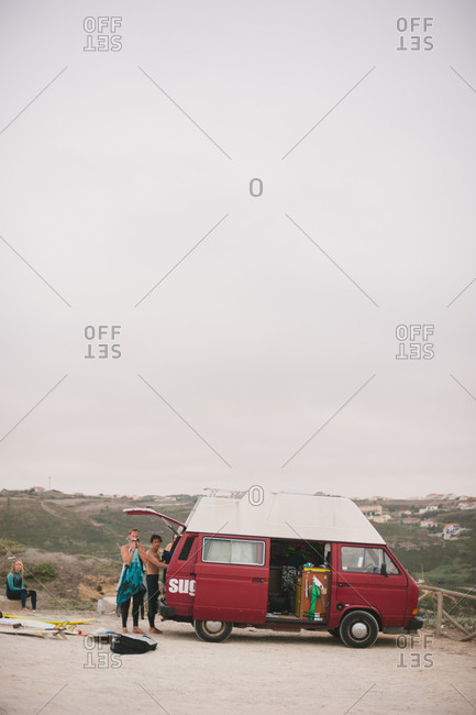 Ericeira, Portugal - September 9, 2015: Surfers getting ready by van