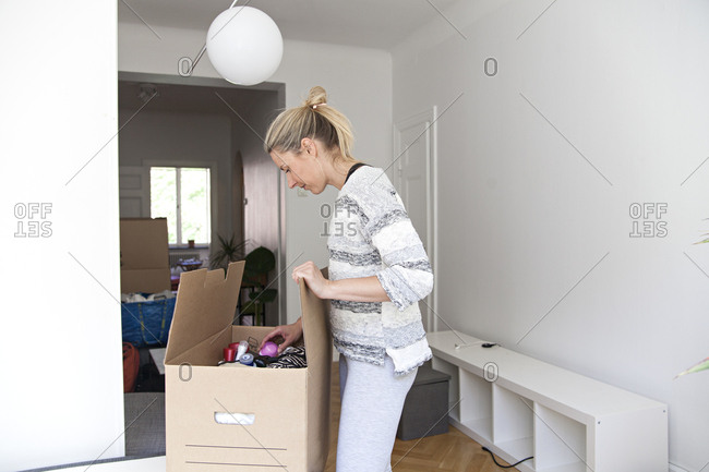 Woman packs a box on moving day