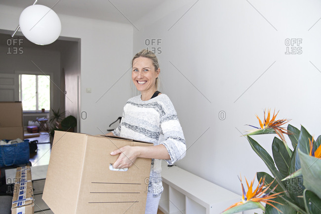 Woman carrying a box on moving day