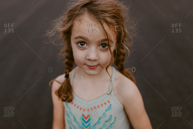 Girl in pigtails with brown eyes