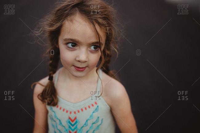 Girl in pigtails looking away