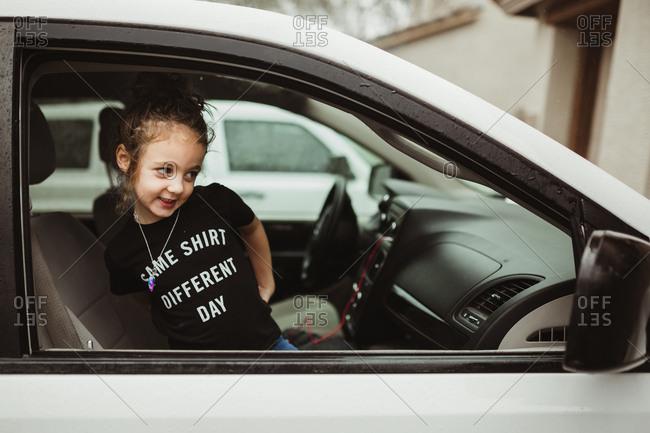 Girl in T-shirt in a car