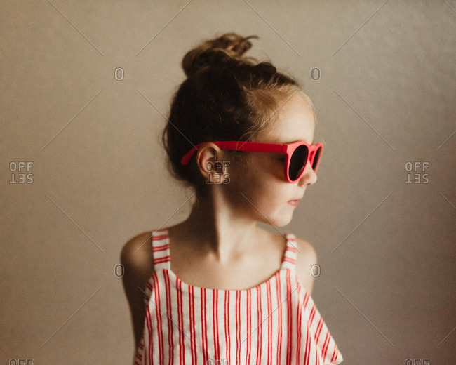 Girl in red sunglasses and tank top