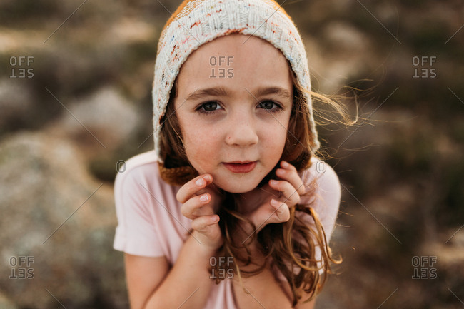 Girl with hat in desert setting