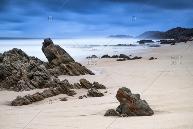 Long exposure image of rock formations on a Yallingup beach.