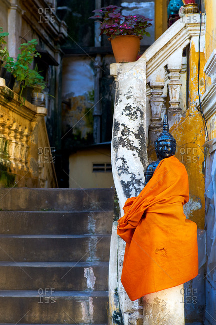 Buddha statue wrapped with monks robe