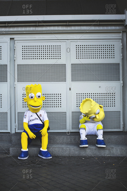 Madrid, Spain - October 14, 2015: Two people dressed in Bart Simpson figures are seen outside at the Estadio Santiago Bernabeu stadium in Madrid