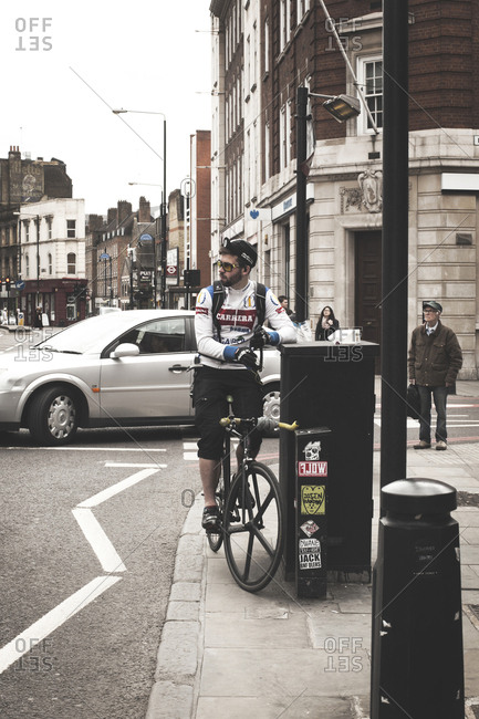 London, United Kingdom - May 5, 2013: A bicycle messengers on a racing bike is having a break in London