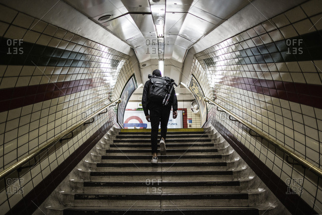 London, United Kingdom - September 6, 2015: A man is walking up the stairs in the London Underground, which is also known as The Tube
