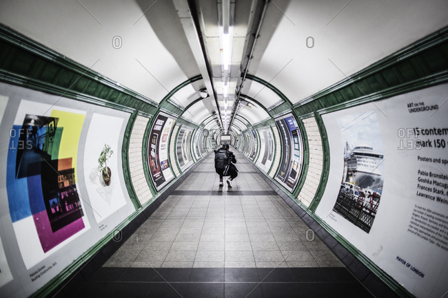London, United Kingdom - September 6, 2015: A guy is taking pictures in the London Underground, which is also known as The Tube