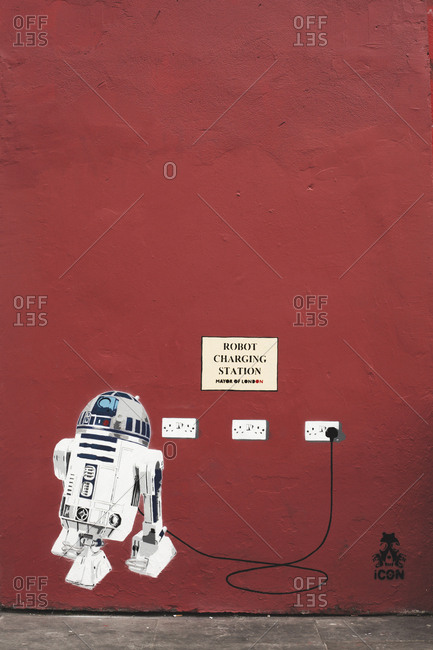 London, United Kingdom - May 7, 2013: R2-D2 charging station street art seen on a wall in London