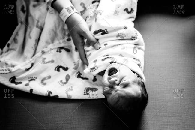 Woman swaddling newborn baby