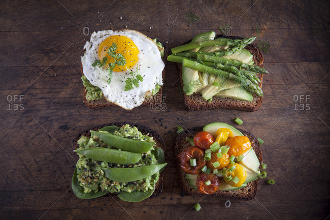 Toast topped with vegetables and eggs