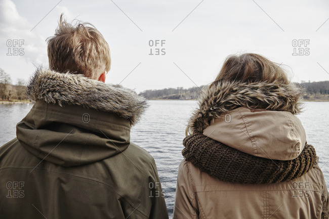 Germany- Potsdam- rear view of young couple looking at Havel River
