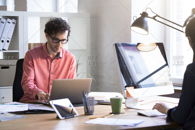 Man and woman working in office