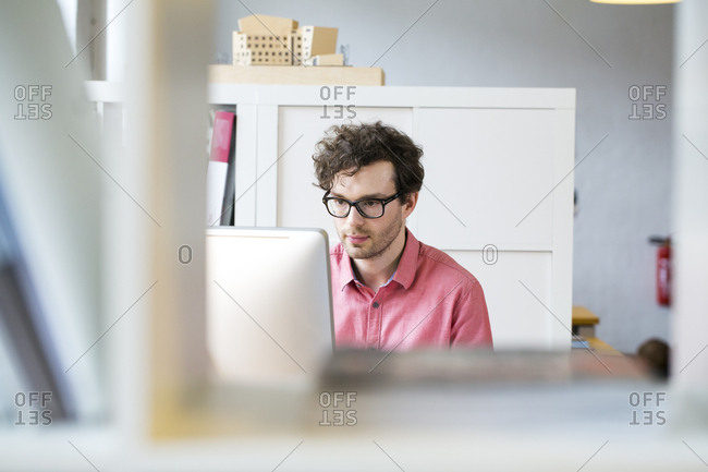Man in office looking at computer screen