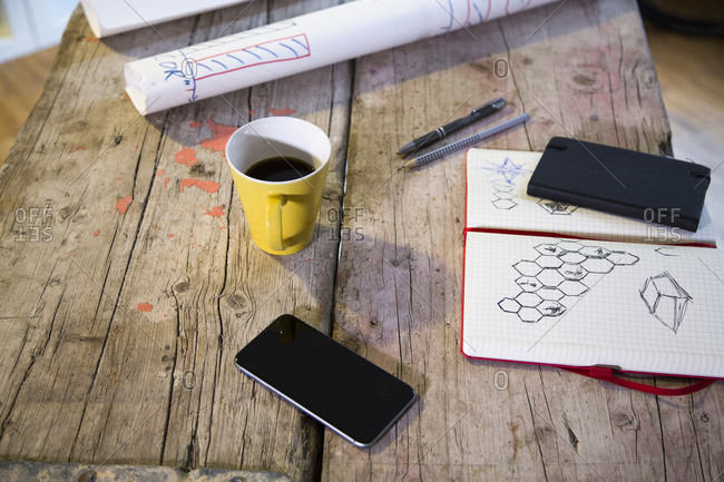 Notebook- smartphone and coffee cup in modern informal office