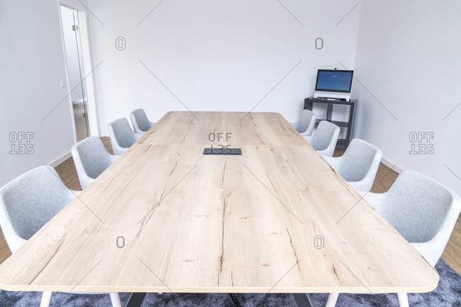 Empty board room with wooden conference table