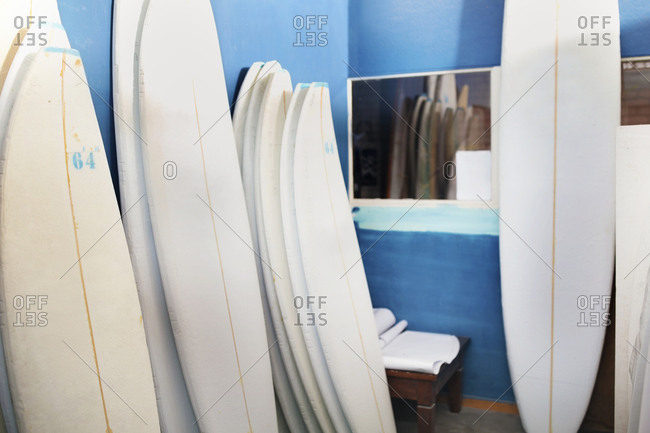 Surfboard shaper workshop- surfboards stacked in storeroom