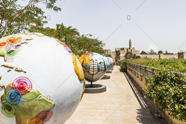 Israel, Jerusalem - June 12, 2017:  Mamilla Esplanade, the art exhibition Cool Globes, on the background the Tower of David (or Citadel of Jerusalem)