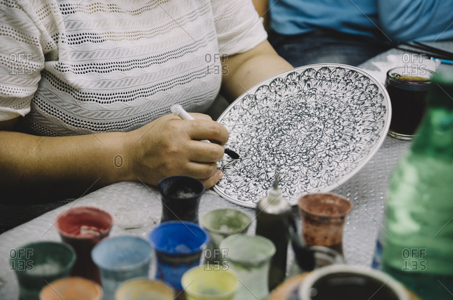 Traditional hand painted ceramics in Cappadocia, Turkey. Closeup on woman's hands.