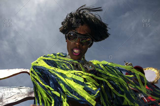 Rome, Italy - June 10, 2017: Portrait of a person wearing sunglasses and elaborate costume at gay pride celebration