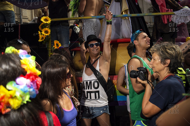 Rome, Italy - June 10, 2017: Man with arm raised standing among crowd at gay pride celebration