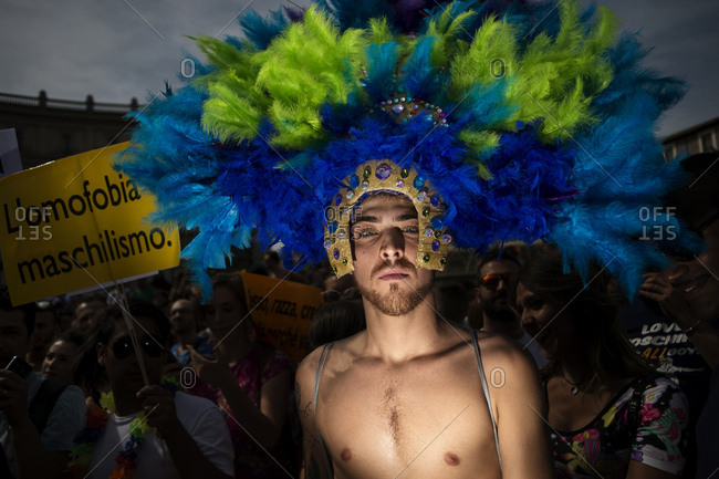 Rome, Italy - June 10, 2017: Portrait of a man in feathered headdress at gay pride parade