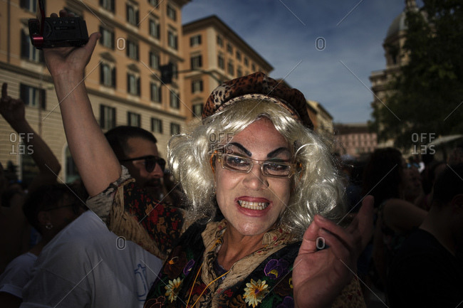 Rome, Italy - June 10, 2017: Portrait of a person in costume holding a camera during gay pride celebration