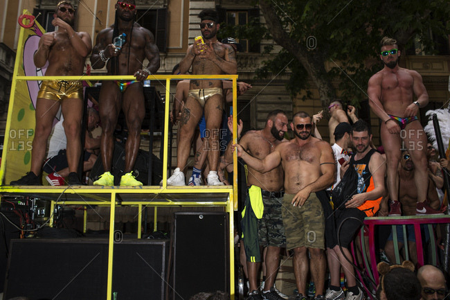 Rome, Italy - June 10, 2017: Gay men wearing shorts on stage at gay pride celebration