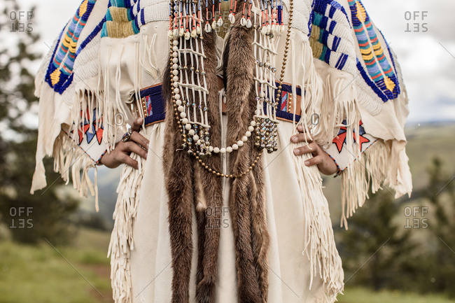 Close up of Native American regalia on young woman