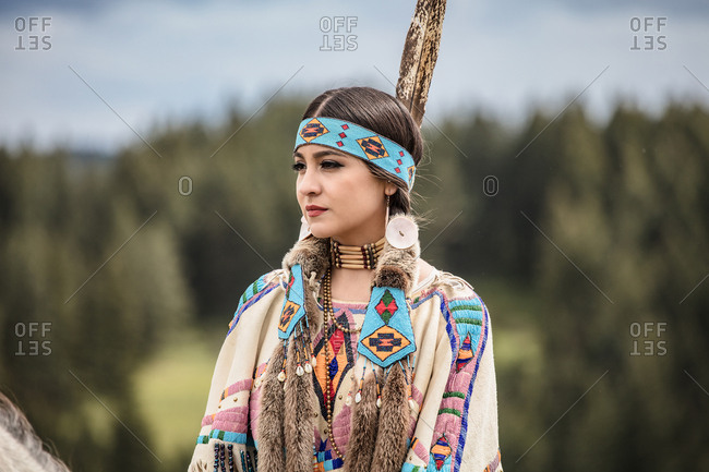 Native American young woman dressed in regalia