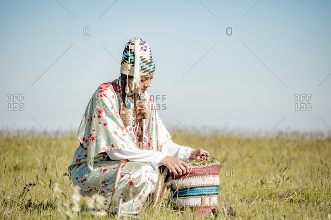 Native American woman in a field at the Umatilla Reservation, Pendleton, Oregon