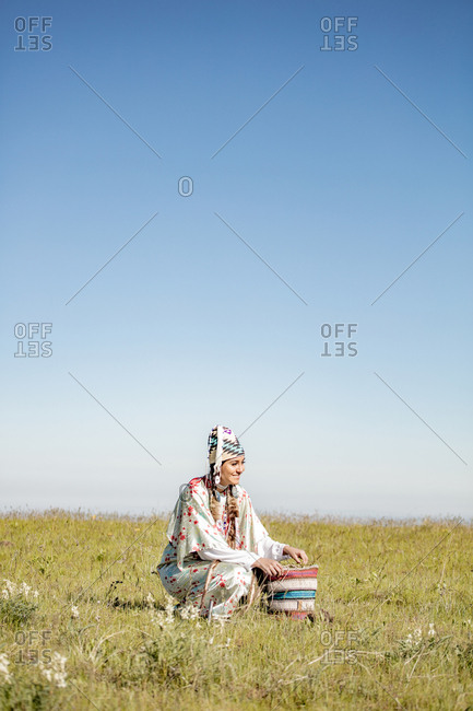 Native American woman in a pasture at the Umatilla Reservation, Pendleton, Oregon