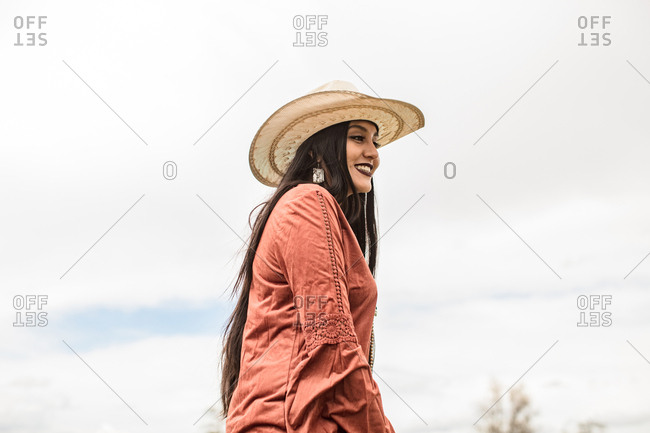 Low angle view of woman in cowboy hat