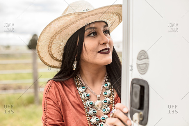 Woman in western hat with silver and turquoise jewelry